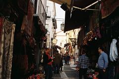 ay que no te metas en quereles, (Lentejas Puag) Tags: granada spain andalucia calle elvira street zoco market 35mm nikonf70