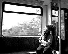 Catch the Sun! (floressas.desesseintes) Tags: berlin sbahn suburbantrain woman jungefrau youngwoman bewegungsunschärfe blur frau streetfotografie schwarzweis