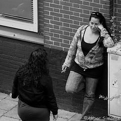 Smoke break (Akbar Simonse) Tags: straatfotografie streetphotography streetshot straatfoto women smoking people candid rookpauze cigaret holland netherlands nederland zwartwit bw blancoynegro bn monochrome vierkant square akbarsimonse