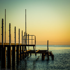 Out of reach (Anthony P26) Tags: category seascape sunrise travel travelphotography glow goldenhour goldenlight horizon coast coastline coastal pier structure wooden timbers fence posts reflection sky sea water mediterranean canon550d canon canon1585mm outdoor