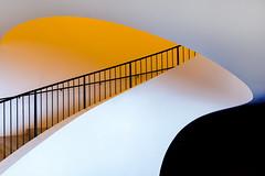 Up the stairs, rickety (Maerten Prins) Tags: germany duitsland deutschland hamburg stair stairs stairwell curl curve soft white orange railing black metal contrast elbphilharmonie elphi concerthall hafencity new architecture