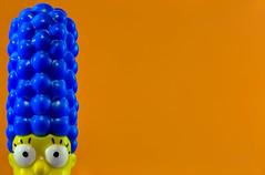 Blue Hair in an Orange World (KellarW) Tags: watching mother synecdoche memeable iseeyou marge lego dontdoanythingiwouldntdo memable macromondays orange margesimpson flickrfriday blue mom watchingyou legosimpsons orangeandblue meme simpsons macro blankspace