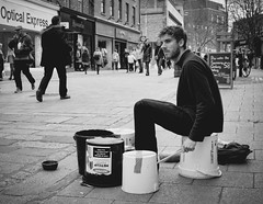 95/365 Dreaming Drummer Boy (denise.ferley) Tags: norwich city citylife candid bw blackandwhitephotography busking streetphotography street sonynex5 shopping shoppers sitting peoplewatching people pavement life fun england 365 3652017 uk urban oneaday thisisengland drummer drumming