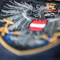 symbol of authority (ewaldmario) Tags: macromondays macromonday cloth ewaldmario blue police eagle austria symbo clothtextile textile blazon coatofarms macro closeup micronikkor nikon 105mm narrowfocus focus bokeh