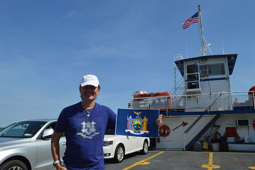 Ryan Janek Wolowski waving the state flag of New York while riding on the CSF Cross Sound Ferry between New London CT Connecticut and Orient Point Long Island NY New York