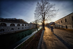 Walking alongside the Ljubljanica river (marko.erman) Tags: ljubljana slovenia slovenija city capital town architecture sunset sun shadow tree river ljubljanica foodmarket arches arcades jožeplečnik light architecte