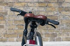 Brown Seat and Handlebars.  Duke of York Square, Chelsea, London (MJ Reilly) Tags: bike velo bicycle bicycles seat wheel nikon d90 chelsea saatchi sloanesquare citybike urban london fits cykel fahrrrad bicicletta sykkel dukeofyork dukeofyorksquare handlebars reflector bikerack 50mm