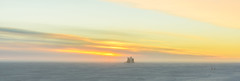 Sunset dream (redfurwolf) Tags: southpole antarctica icecubelab icecube sunset light orange yellow clouds ice snow flags sky building architecture landscape nature sunsetlight sonyalpha a99ii sal2470za sony panorama pano