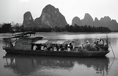 Li River - ferry leaving  Xingping 1993 (Bruce in Beijing) Tags: china guangxi yangshuo xingping riverlife transport ferry people limestone landscape