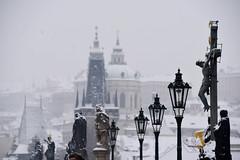 Snow in Prague (jmarnaud) Tags: czech prague 2017 snow winter charles bridge people statue river old building walk street