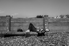 Planked (EyeOfTheLika) Tags: ifttt 500px sky landscape people spring beach bw black white woman sleep uk england fence wood monochrome sand wall bnw blonde one outdoors horizontal lieing snooze lie streetphotographer lika