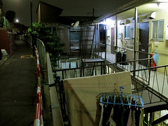 (  / Yorozuna) Tags: road light house japan night tokyo alley shinjuku backalley apartment nightscape laundry alleyway             apartmenthouse         akebonobashi     wakamatsukawada sumiyoshichou