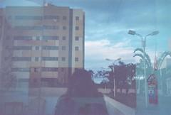 (hnnhcrvlh) Tags: brazil film window espelho brasil 35mm person mirror pessoa janela filme prdio paraiba predio paraba campinagrande yashicamf3