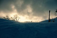 Approaching (Explored) (OzGFK) Tags: winter snow japan clouds asia hokkaido afternoon skiing niseko hirafu