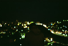 nikon FM2 - Waiting for a light that never comes (Federica [C]) Tags: city boy urban man slr film night analog 35mm vintage dark 50mm lights back nikon flickr darkness kodak bokeh f14 grunge grain 200iso citylights indie epson luci analogue dust nikonfm2 analogica imperia kodakgold kodakfilm analogic grana pellicola kodakgold200 analogico analogcamera scanfromfilm tumblr darkvintage canon600d darkgrunge v370 epsonv370 digitizedwithdslr