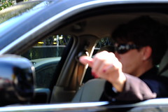 The Blurry Business Woman (BDRoth (on a much needed break, back soon!)) Tags: woman face car lady female glasses blurry driving hand random bokeh candid femme business suit