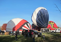 Several hot air balloon inflating for launch (ali eminov) Tags: balloons nebraska celebrations wakefield hotairballoons wakefieldballoondays