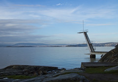 To cold for a bath (Vidar Ringstad, Norway) Tags: autumn light shadow sea sky sun cold fall nature water oslo norway clouds stairs canon fence eos norge rocks horizon hill norwegen diving level 7d fjord foreground oslofjorden waterscape natureshot waterlevel divingtower naturepic ingjerstrand
