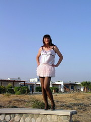 Statue of liberty (Paula Satijn) Tags: pink sexy stockings girl sunshine legs outdoor cyprus skirt tgirl transvestite satin miniskirt gurl