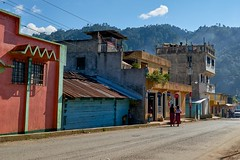 Rio Azul - Nebaj (Sinar84) Tags: street travel blue trees houses red sky orange white black green shop kids clouds forest buildings women october guatemala smoke traditional gray violet centralamerica ixil 2014 nebaj rioazul