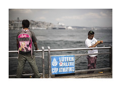 Barbie has a crash for fishermen (jrockar) Tags: street city travel people urban 3 canon turkey lens photography prime dof shot mark f14 candid iii 14 streetphotography documentary istanbul snap human instant 5d approved mm moment 50 mk 5014