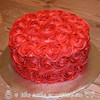 Red rosettes birthday cake