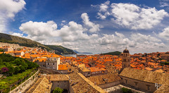 Medieval Dubrovnik Rooftop Panorama (RobertCross1 (off and on)) Tags: 1250mmf3563mzuiko adriatic croatia dalmatia dubrovnik em5 europe hrv hrvatska omd olympus architecture bluesky church city cityscape clouds hills landscape medieval panorama sea seascape trees urban vinyard water