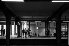 Landungs| |______| |brücken / the art of waiting (Özgür Gürgey) Tags: 2017 35mm bw d750 hamburg landungsbrücken nikon samyang architecture columns shadows street waiting germany