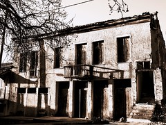 Once upon a time... (kallchar) Tags: oldbuilding building ruins village streetphotography street city urban monochrome nocolor windows olympus olympusomdem10 flickr timed past memories tree melancholy abandoned haunted sealed shadows school concrete kyparissia greece messinia