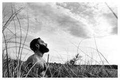 Wilderness V (tg | photographer) Tags: man boy guy seaside clouds sky 35mm analog analogic monocromo black white blackandwhite ilford hp5 nature wild wilderness