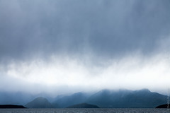 Stormy sky over Lake Manapouri in New Zealand (Dmitri Naumov) Tags: horizon 2010 nature water lake fiordland pond newzealand rippled badweather mountainrange southland moodysky environment distant tropicalclimate landscape cloudy outdoor beautyinnature southislandnewzealand waves stormyweather storm dark cloudscape sky overcast ambience stormy photography nopeople shore manapouri nobody rain remote dramaticsky
