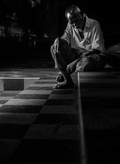 Tired (relishedmonkey) Tags: nikon d5300 tired man alone black white monochrome vellore outside seated sitting city lighting night light one old person 35mm 18g