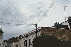 | Cables | London | 2013 (Marco Lehmbeck I Trippy Tales) Tags: street autumn houses roof england sky house london film analog 35mm canon photography grey wire tales kodak britain herbst great himmel haus grau cable cables wires electricity analogue trippy dach strom kabel huser strommast hsuer