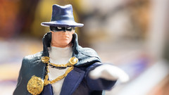 KL, MALAYSIA – OCTOBER 23, 2014: Slightly defocused and closeup figurine of The Phantom Stranger, a mysterious figure in the history of the world. (awiekupo) Tags: city blue man male celebrity standing buildings insect happy comic force power character coat beefy cartoon fame security health disguise hero superhero trust mysterious cape strong dccomics cheerful phantom success immortality thestranger thephantom bluebeetle sorcery jaimereyes phantomstranger dimensiontravel bluebody plasmagun bluehero illustrativeeditorial bluefullbodysuit fullbofysuit