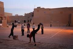 Afghan kids playing football in the old city of Yazd (Jeppe Schilder Photography) Tags: schilder kids canon children photography football asia fotografie iran middleeast persia afghan jeppe yazd jeppeschilder