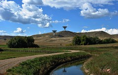 Antenna Hill (Let Ideas Compete) Tags: road 2 two white clouds fence landscape big colorado technology ditch dish space pair hill fluffy hills cumulus astronomy dirtroad curve hillside curved antenna rolling channel rollinghills irrigation astronomical gravelroad dishantenna cassegrain cumulusclouds radiotelescopes curvedroad irrigationditch cumuluscloud 2antennas twoantennas cassagrain