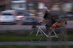 Evening commute (lenswrangler) Tags: lenswrangler digikam elcerrito bicycle mother child ohlone greenway motionblur flickrfriday bike helmet cycling wheel panning blur people rainier