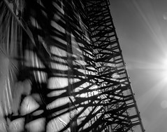 light and shadows (marianna_a.) Tags: sun light shadow building scaffold stairs architecture urban lines reflection refraction beam mirror spectrum bw blackandwhite monochrome monochromatic mariannaarmata