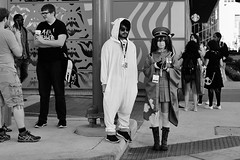 At Attention (burnt dirt) Tags: houston texas downtown city town mainstreet street sidewalk streetphotography fujifilm xt1 bw blackandwhite girl woman people person animae cosplay costume uniform matsuri convention boots military hat cap pokemon hamster man group crowd stockings whitestockings kneehigh medal longhair glasses sunglasses phone cellphone discoverygreen georgerbrown