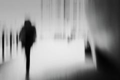 She's Arriving @Bus Station (JohnnySillyArty) Tags: girl walking motion blur light image blackandwhite impressionistic artistic artphotograph leg indoor