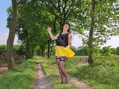 Gust of wind (Paula Satijn) Tags: sexy hot girl skirt miniskirt satin silk silky shiny yellow gurl tgirl black outside tree spring smile fun joy happy legs stockings lace stockingtops lacy sensual
