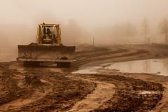 A New Road (sailor_smb) Tags: road construction mud water reflection dozer red solivita florida poinciana heavyequipment