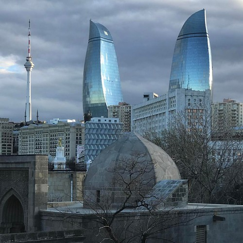 Old and new / One final shot from Baku before we fly out this morning. The ultra-modern Flame Towers as seen from the 15th-century Palace of the Shirvanshahs. #travel #azerbaijan #UNESCO