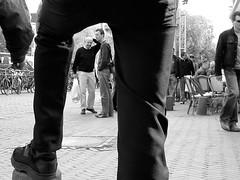 Leg framing mono (chrispage009) Tags: people nieuwmarkt amsterdam terrace blackandwhite