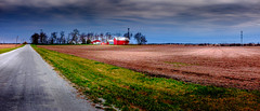 Ain't that America.... (Geoff Eccles) Tags: farmbuildings ploughed sunbreakingthrough panorama greysky redbuildings cornfields farmtrack sunspots readytosow cloudy midwest workingfarm telegraphpoles farmroad redfarmbuildings ploughedfield sunlight farmhouse midwestfarm treeline clouds bigfarm plowed fields verge farm farming farmer grassverge graysky