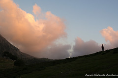 A man walks in front of the clouds at dusk (adventurousness) Tags: bluecity chefchaouenthebluepearl thebluecity blue chaouen chefchaouen clouds dusk landscape morocco travel shadow sillhouette sunset