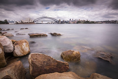 Sydney seen from Mrs Macquarie's Chair, Australia (Tim van Woensel) Tags: mrs macquaries chair australia down under oz sydney travel peninsula harbour domain royal botanic gardens opera house bridge icons rocks long exposure clouds