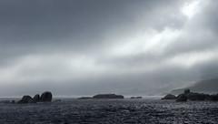 Lifting (Michele's POV) Tags: monochrome monochromatic skyscape sky sea seascape rocks greyandsilverhues mist fog