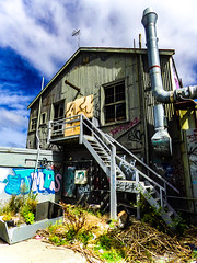 Trouble At T' Mill (Steve Taylor (Photography)) Tags: troubleattmill mill chimney aerial graffiti architecture tag building window wall stairs steps blue green brown metal iron wood wooden newzealand nz southisland canterbury christchurch cbd city weeds corrugated shadow cloud sky tmds