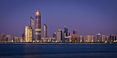 Abu Dhabi Corniche (AdeyH) Tags: city sunset sea sky beach water architecture night buildings boats lights evening asia colours gulf towers uae arabic abudhabi arab corniche